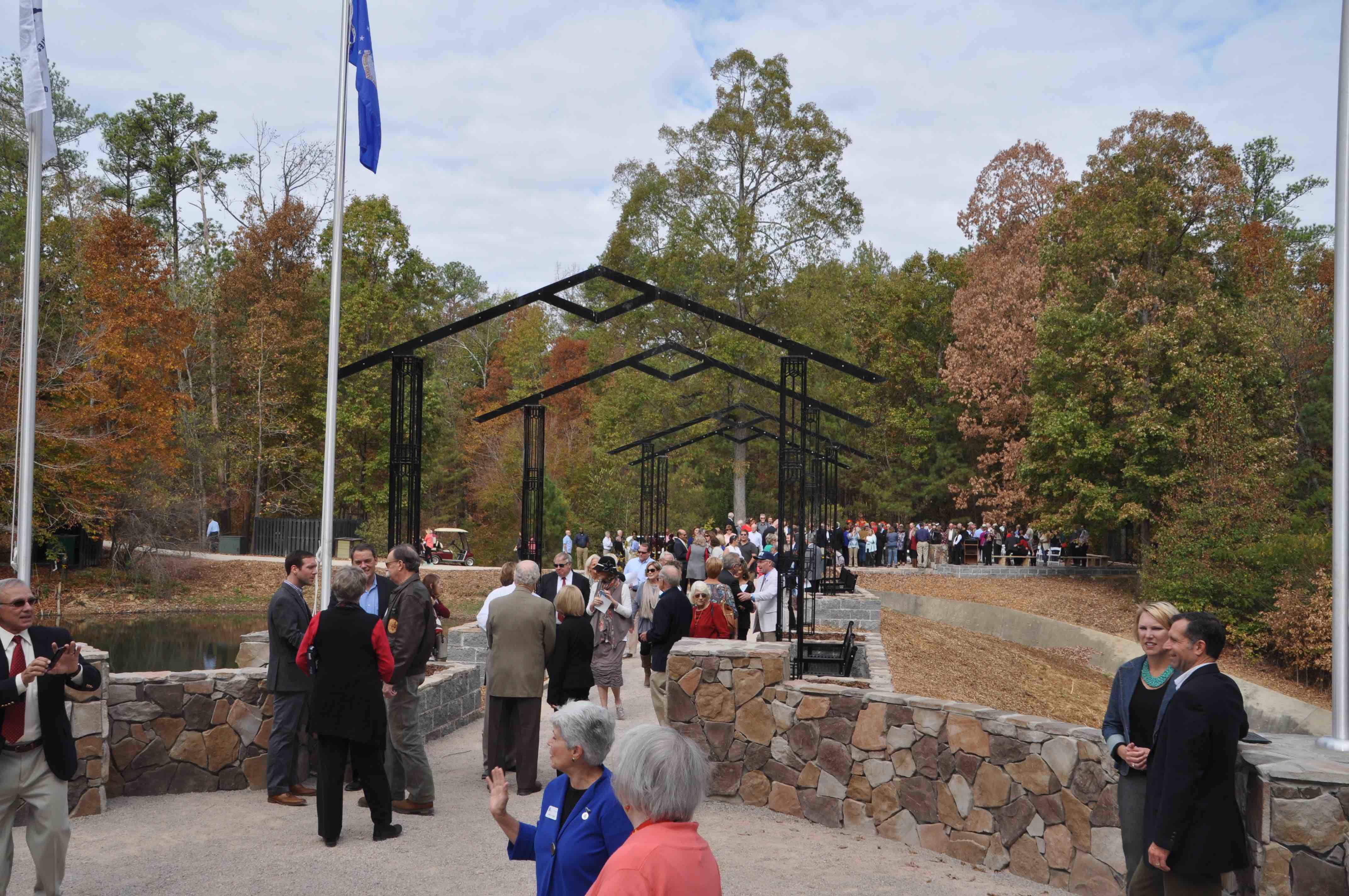 More than 200 people gather to unveil Veterans Memorial Arbor at ...