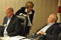 Board members prepare for meeting.