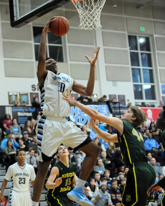 Austin Wiley drives to the basket for Spain Park