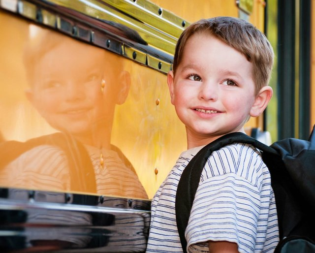 pre-k boy with school bus