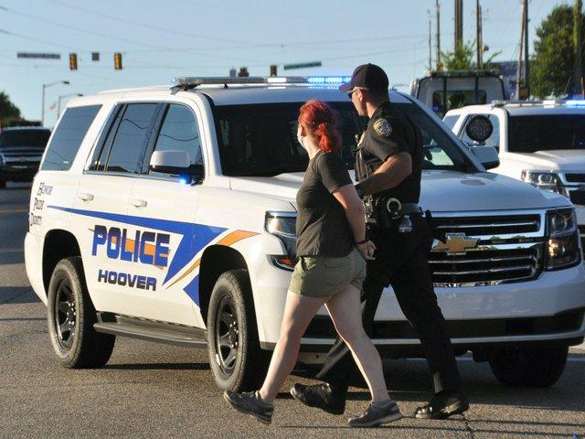 SUN-COVER-COVID-19-Crime-Hoover_protest.jpg